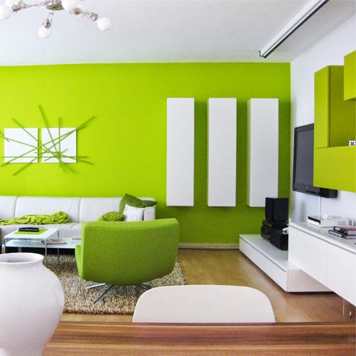 Muebles verdes en un espacio interior de una casa diseñado con ese color